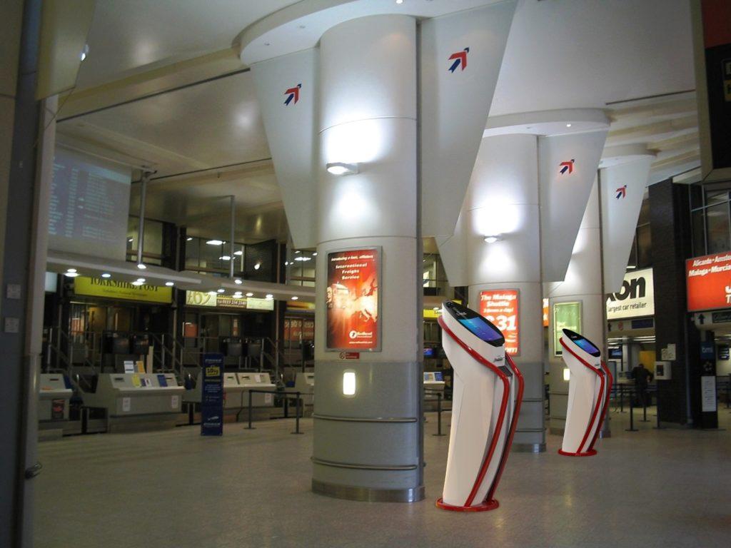 qpass airport checkin counter kiosk